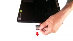 Use fingers to release and slide out SD Card.