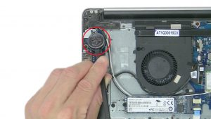Use plastic scribe to pry out and remove CMOS Battery.